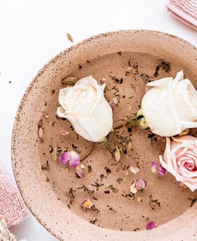 Pink roses inside of brown bowl